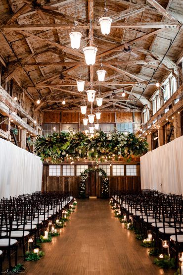 Seattle wedding with greenery, candle aisle decor, floral chandelier | Tobey Nelson Events | image by Alante Photography