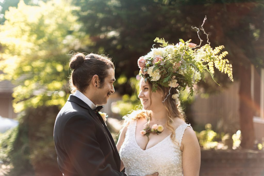 Bride with floral headpiece and fresh flower necklace | Tobey Nelson Events | J Tobiason Photography