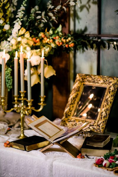 Prayer book, mirrors and candles for a Persian Sofreh | Seattle Wedding at Sodo Park | Floral and Event design by Tobey Nelson | image by Alante Photography