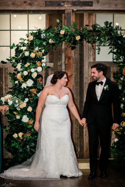 Foam-free wedding arch with greenery and white flowers | Seattle Wedding at Sodo Park | Floral and Event design by Tobey Nelson | image by Alante Photography