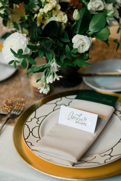 Wedding Details with gold accents and calligraphy placecard | Seattle Wedding at Sodo Park | Floral and Event design by Tobey Nelson | image by Alante Photography