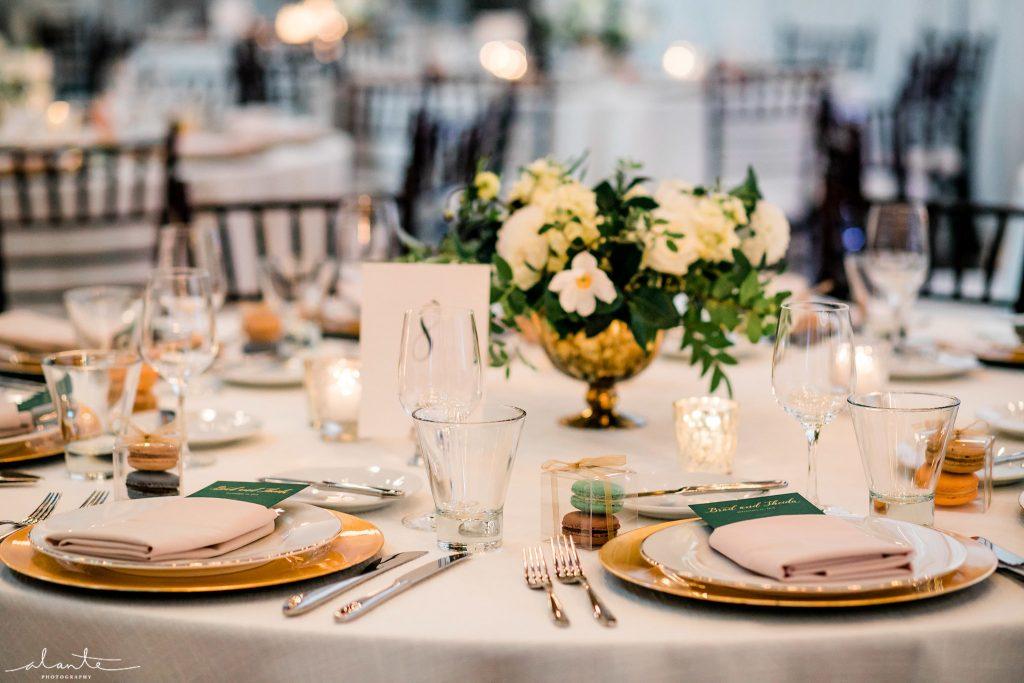 Wedding table with floral centerpiece, gold chargers and green menus | Seattle Wedding at Sodo Park | Floral and Event design by Tobey Nelson | image by Alante Photography