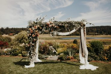 Wedding arbor with foam-free florals in blush and white | Romantic summer wedding at Fireseed Catering on Whidbey Island | Wedding flowers and planning by Tobey Nelson Events | image by Jordan Voth Photography