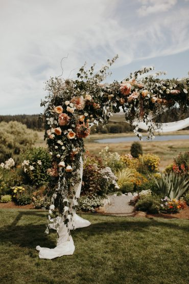 Wedding arbor with foam-free florals in blush and white   Romantic summer wedding at Fireseed Catering on Whidbey Island   Wedding flowers and planning by Tobey Nelson Events   image by Jordan Voth Photography
