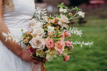 Bridal bouquet with blush Lisianthus, buff Rose, Butterfly Ranunculus and bleached Ruscus by Tobey Nelson Events | Suzanne Rothmeyer Photography | Neutrals with Blush & Black Accents