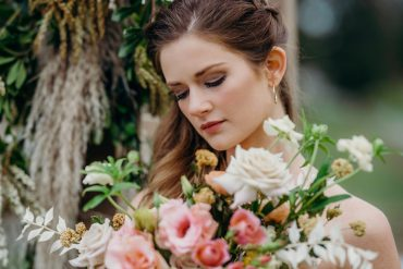 Bridal bouquet with blush Lisianthus, buff Rose, Butterfly Ranunculus and bleached Ruscus by Tobey Nelson Events | Suzanne Rothmeyer Photography | MakeUp by Marqui Artistry