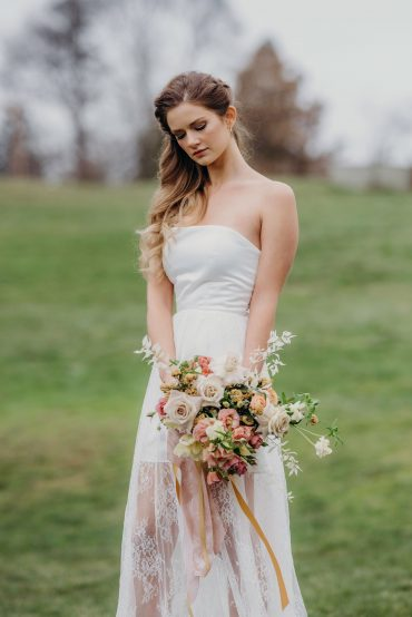 Bridal bouquet with blush Lisianthus, buff Rose, Butterfly Ranunculus and bleached Ruscus by Tobey Nelson Events | Suzanne Rothmeyer Photography