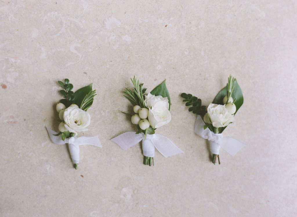 Boutonnieres with Rose and Snowberry |Romantic blush and white wedding flowers for a backyard Lake Washington Lakeside wedding in Seattle | Flowers by Tobey Nelson Events | image by Katie Parra Photography | planning by The Invisible Hostess
