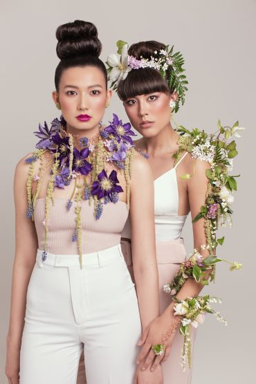 Floral collar, flower tattoo and hair flowers by Tobey Nelson