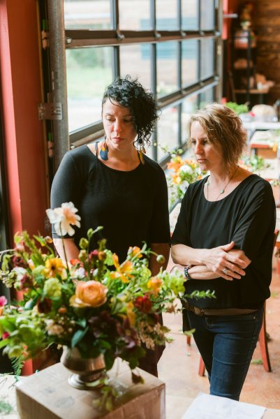 One on one critique of student work at the Whidbey Flower Workshop