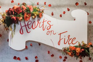 Hearts on Fire sign with floral accent for the 2019 WhidbeyHealth Foundation Gala Fundraiser at FIreseed Catering