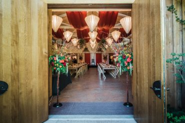 Ceiling draping and entrance florals for a non-profit fundraising gala event at Fireseed Catering on Whidbey Island