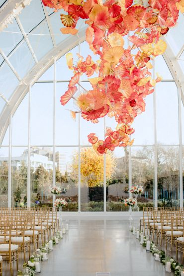 Wedding Ceremony at Chihuly Glass Garden with flowers by Tobey Nelson Events photo by GH Kim Photography