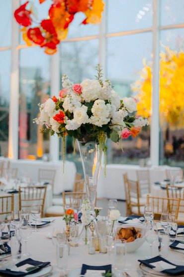 Elevated centerpiece | foam free floral designs | white and coral wedding |