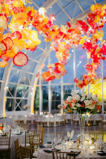 Wedding reception with elevated centerpieces | Wedding Ceremony at Chihuly Glass Garden with flowers by Tobey Nelson Events photo by GH Kim Photography