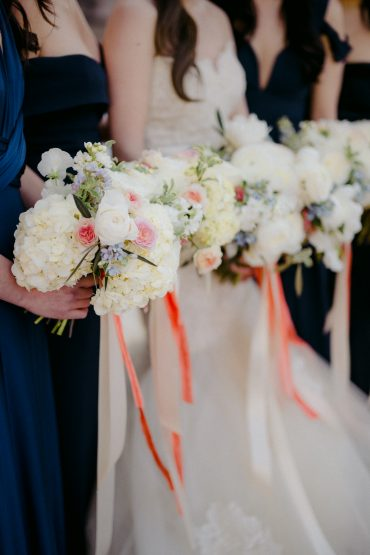 Bride and bridesmaid bouquets in white with pops of coral and blue | Roses, Peony and Ranunculus | Seattle Wedding Flowers by Tobey Nelson Events | image by GH Kim Photography