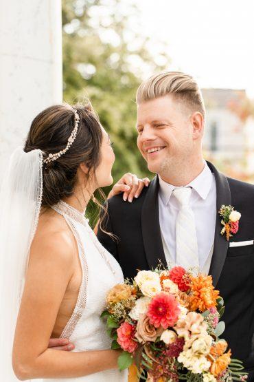happy wedding couple with flowers