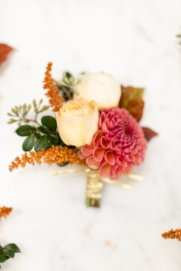 Boutonniere for a Groom with white rose and fall toned Dahlia | Kirkland wedding flowers by Tobey Nelson | image by Stormy Peterson