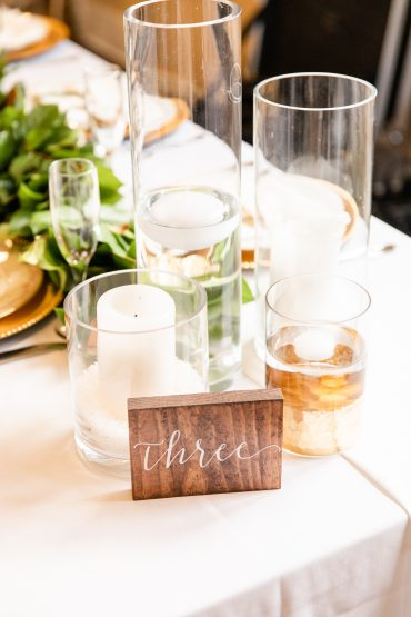 candle collage centerpiece with a wooden table number