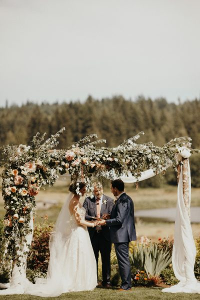 A foam-free wedding arch made with locally grown flowers