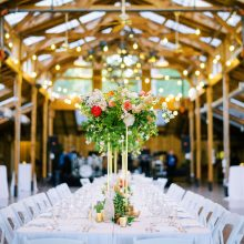 Foam free elevated centerpiece | Kiana Lodge wedding flowers by Tobey Nelson | image by Ryan Flynn Photography