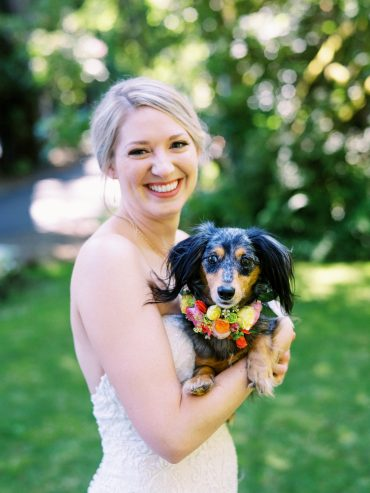 Bride and her dog with a floral dog collar | Kiana Lodge Wedding Flowers by Tobey Nelson | image by Ryan Flynn Photography