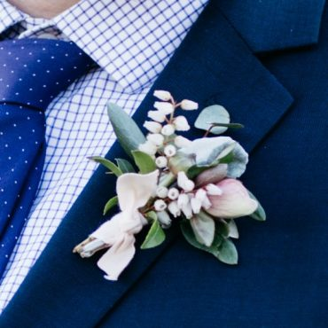 Blush and white Boutonniere with Hellebore, Pieris and Dusty Miller for a Whidbey Island Destination Elopement | Flowers by Tobey Nelson Events | image by Melissa Days Photography