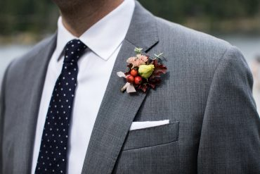 Groom's boutonniere with Rosehips | Whidbey Island wedding flowers by Tobey Nelson | image by Jenny Jimenez