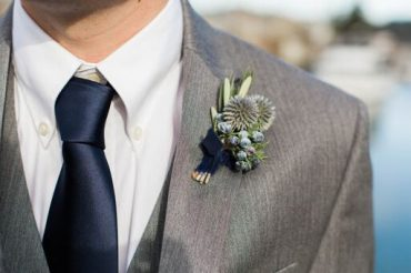 Blue boutonniere with Juniper, Olive and Thistle, trimmed in navy velvet ribbon | for a winter wedding at Fireseed Catering on Whidbey Island | flowers by Tobey Nelson |image by Molly Landreth