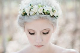 Bride wearing a white fresh flower hairband