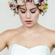 Bride wearing a white and pink flower crown