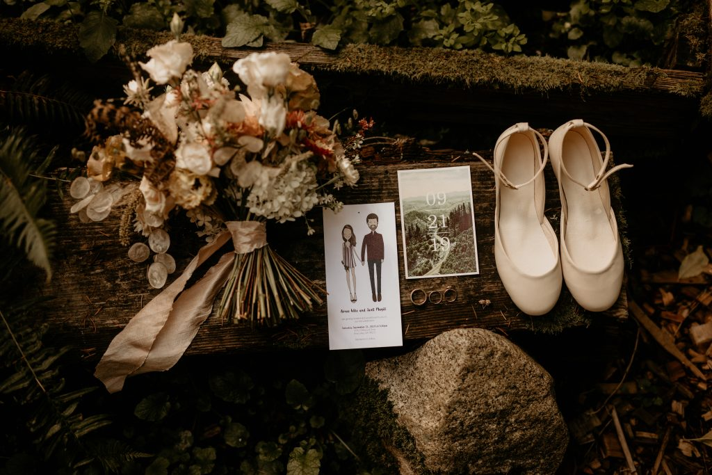Details shot with bridal bouquet and invitation  Earthy Guemes Island wedding   Flowers by Tobey Nelson   image by Breeanna Lasher