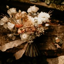 Neutral-toned Bridal bouquet with white, tan and peach flowers | Earthy Guemes Island wedding | Flowers by Tobey Nelson | image by Breeanna Lasher