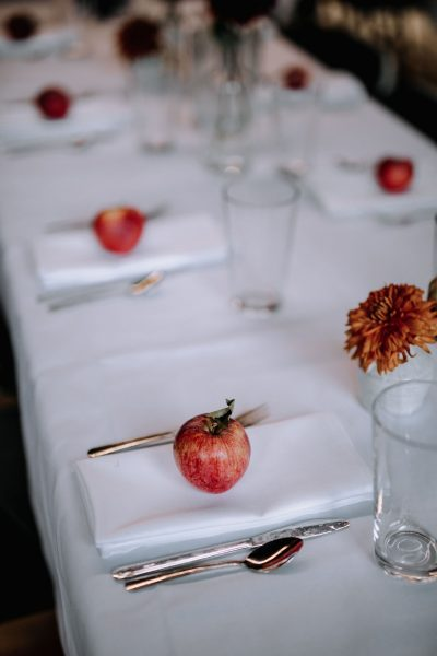 Wedding reception place setting with apple and flower