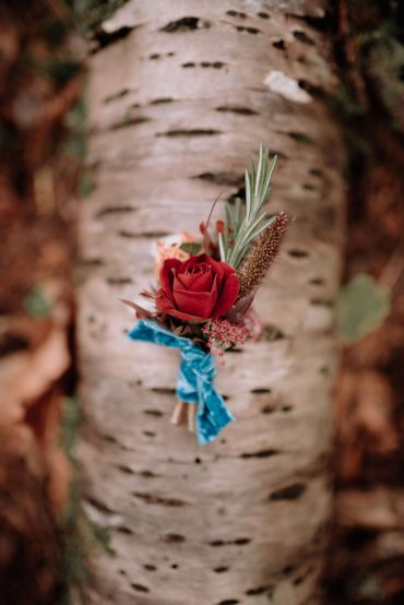 groom's boutonniere with rusty rose and teal velvet ribbon