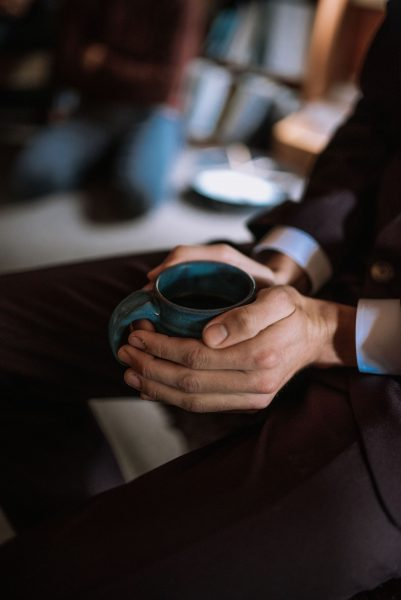 hands around a warm cup of tea