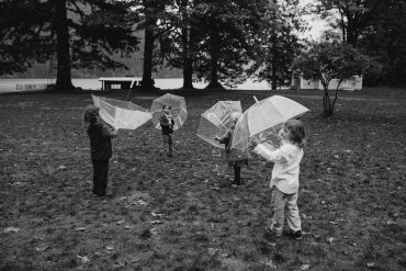 children playing with umbrellas at lake crescent