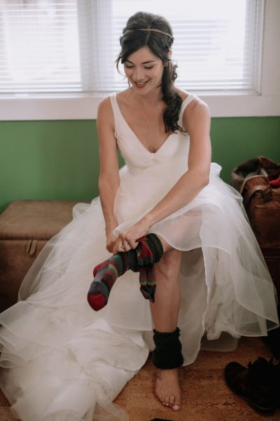 bride with legwarmers for her Lake Crescent fall wedding