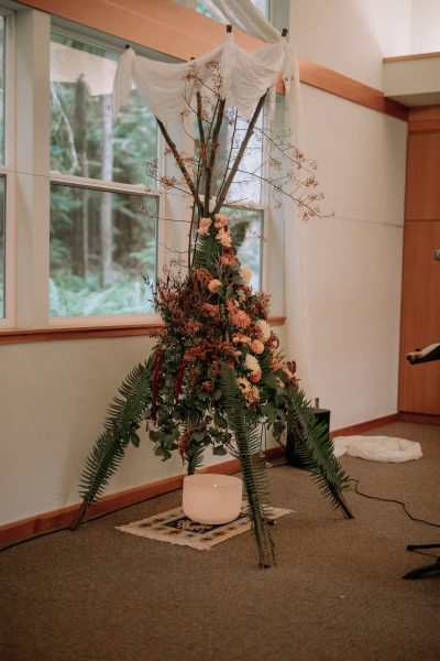 Wedding ceremony sacred altar with rosehips and fern