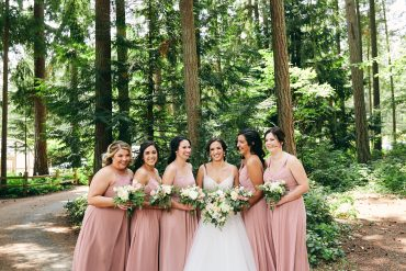 bridesmaids in dusty pink dresses with bouquets