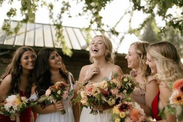 Happy bride and her bridesmaids | Whidbey Island wedding flowers by Tobey Nelson Events | image by Carina Skrobecki