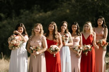 Mix and match bridesmaid dresses in rust, blue and blush | Whidbey Island wedding flowers by Tobey Nelson Events | image by Carina Skrobecki