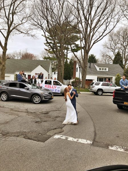 couple getting married in the driveway