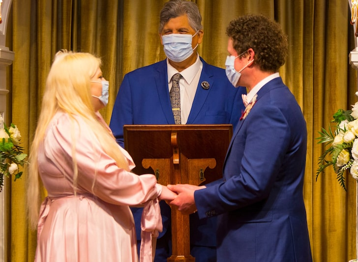 Couple getting married in face masks