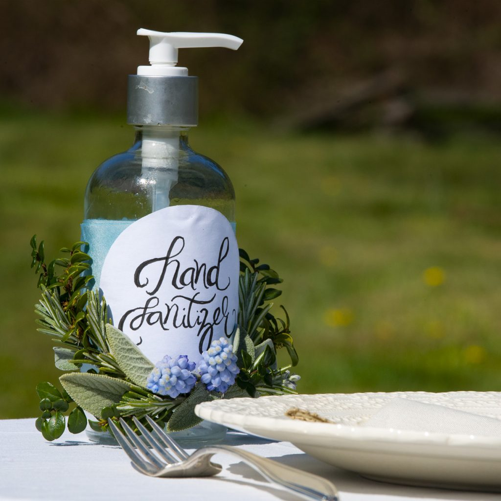 Hand sanitizer dispenser decorated with flowers